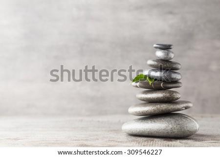 Spa stones on the grey background. - stock photo