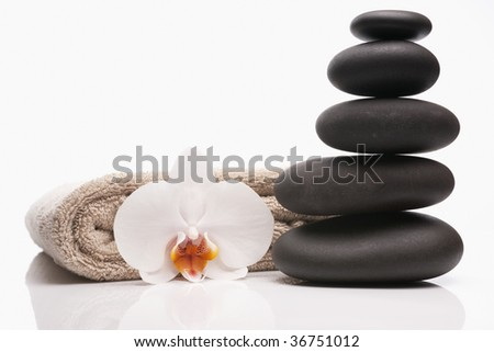 spa stones towel and orchid on white background - stock photo