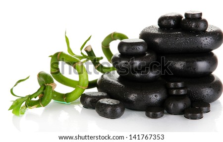 Spa stones with bamboo isolated on white - stock photo