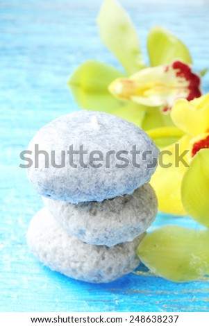 Spa stones with water drops and beautiful blooming orchid close-up - stock photo