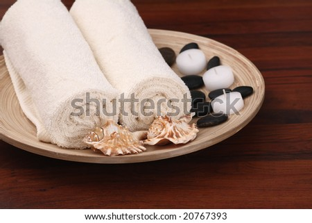 Spa towels with shells - stock photo