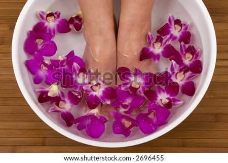 Spa treatment with beautiful orchids - stock photo