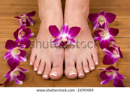 Spa treatment with fresh beautiful orchids - stock photo