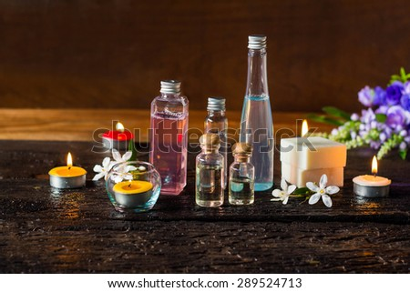 Spa treatment with scented candles and soap on wood. - stock photo