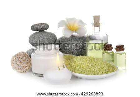 Spa treatment with stones and sea salt, isolated on white - stock photo