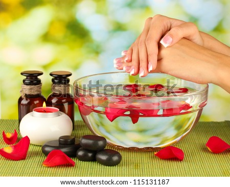 spa treatments for female hands,  on green background - stock photo