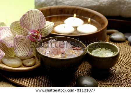 Spa wellness products �orchid ,stones, towel, bowl of Spa salt, candle in bowl on mat - stock photo