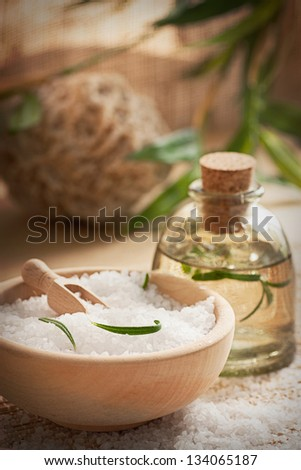 Spa wellness setting with rosemary  and  natural remedies. - stock photo