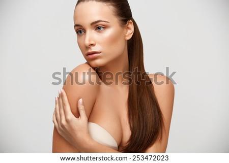 Spa Woman. Beautiful Girl Touching Her Body. Perfect Skin. Body Care. Young Skin - stock photo