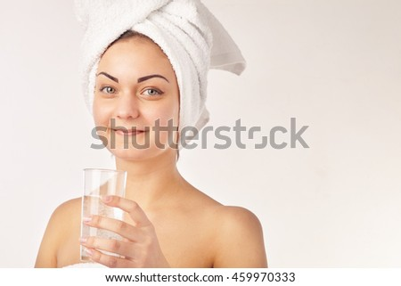 Spa woman. Beautiful girl with glass of water - stock photo