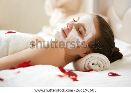 Spa Woman. Beautiful Woman Relaxes on Bed . Face care. - stock photo