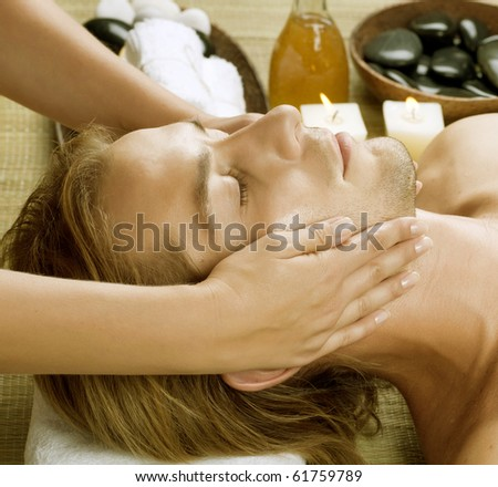 Spa.Young Man getting Face Massage - stock photo