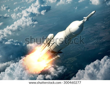 Space Launch System Flying Over The Clouds. 3D Scene. - stock photo