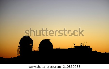 Space observatories at sunrise on top of Haleakala crater on Maui.  Mauna Kea Astronomical Observatory at sunset, Haleakala National Park (Maui-Hawaii), Hawaii, USA - stock photo