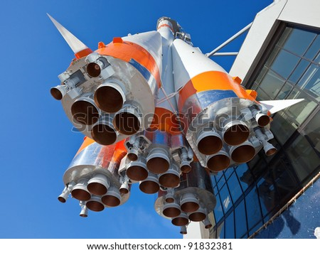 Space rocket against blue sky - stock photo