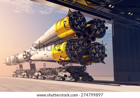 Space rocket near the hangar. - stock photo