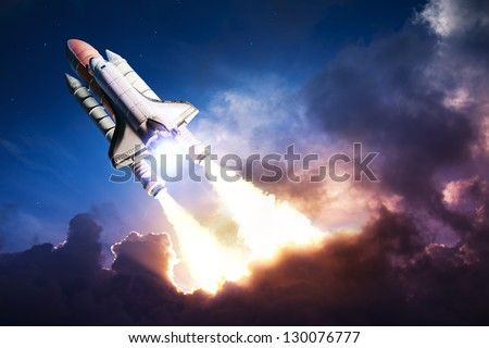 Space shuttle taking off on a mission - stock photo