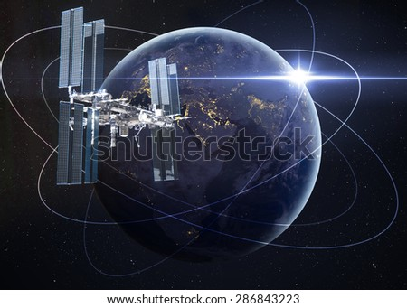 Space Station Orbiting Earth. Elements of this image furnished by NASA - stock photo