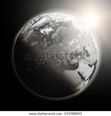 Space view of the sun rising over Europe on black planet Earth. Elements of this image furnished by NASA. - stock photo