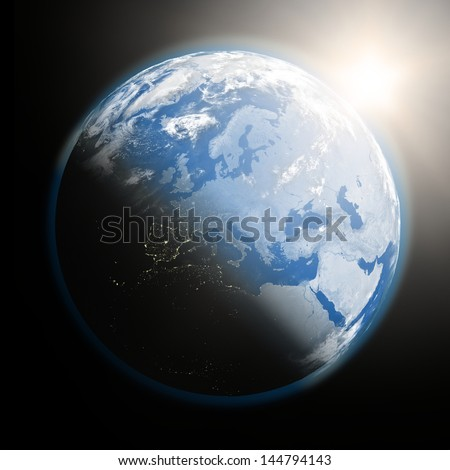 Space view of the sun rising over Europe on blue planet Earth. Elements of this image furnished by NASA. - stock photo