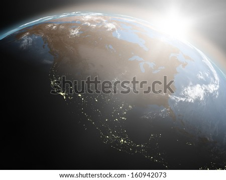 Space view of the sun rising over North America on planet Earth. Elements of this image furnished by NASA. - stock photo