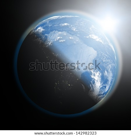 Space view of the sun rising over South America on blue planet Earth. Elements of this image furnished by NASA. - stock photo