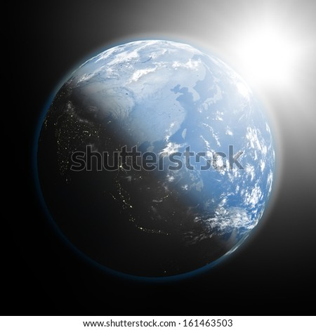 Space view of the sun rising over southeast Asia on blue planet Earth. Elements of this image furnished by NASA. - stock photo
