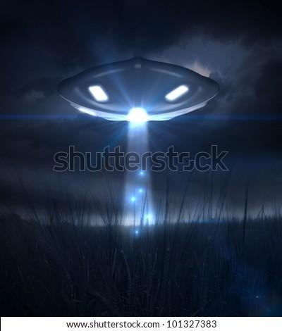 Spacecraft illuminates a field of grain during the night - stock photo