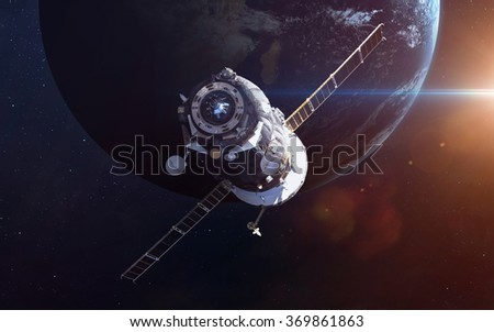 Spacecraft Soyuz orbiting the earth. Elements of this image furnished by NASA - stock photo
