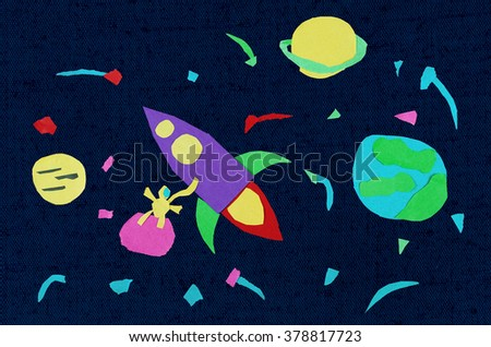 Spaceship in space. Applique made by child from paper on dark textile. - stock photo