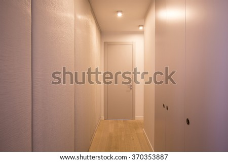 Spacious and neat closet in the hallway  - stock photo