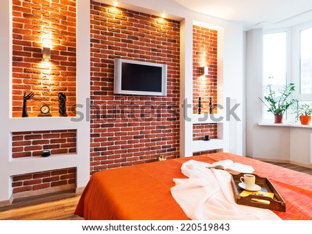 Spacious apartment - Brick wall in modern living room  - stock photo