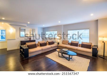 Spacious bright living room in luxury house. Interior design. - stock photo