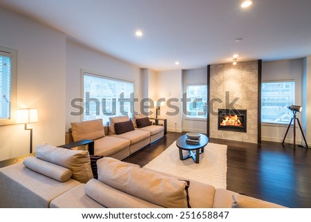 Spacious bright living room with fireplace in luxury house. Interior design. - stock photo