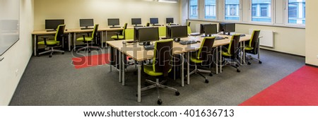 Spacious computer lab in modern medical university. Two rows of desks with new computers - stock photo