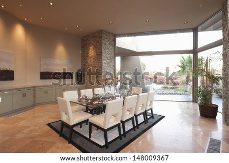 Spacious dining room with floor to ceiling windows - stock photo