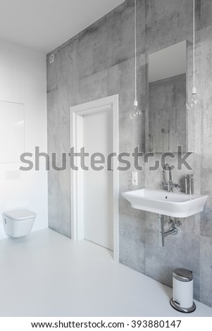 Spacious gray and white bathroom with modern decor - stock photo