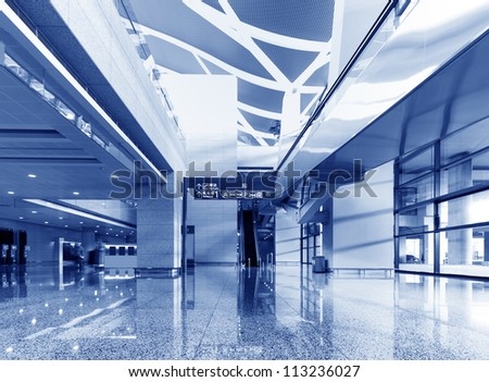 Spacious hall with escalators toned in blue color - stock photo