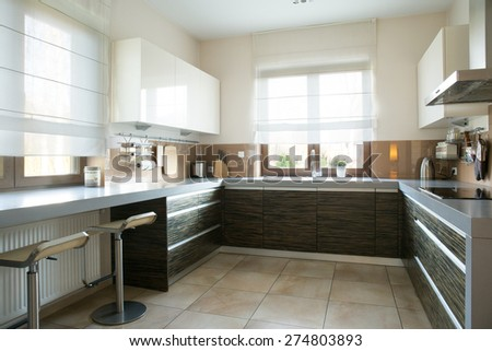 Spacious kitchen with window in modern apartment - stock photo