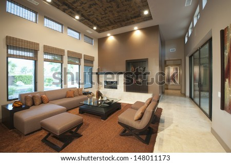 Spacious living room with double height ceiling - stock photo