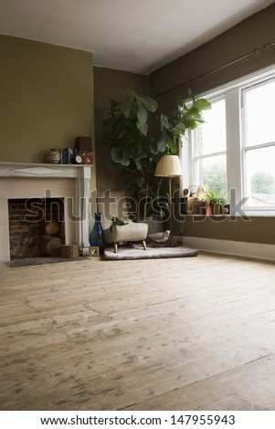 Spacious living room with sitting area in the corner beside fireplace at home - stock photo