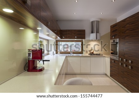 Spacious modern kitchen interior with new appliances - stock photo