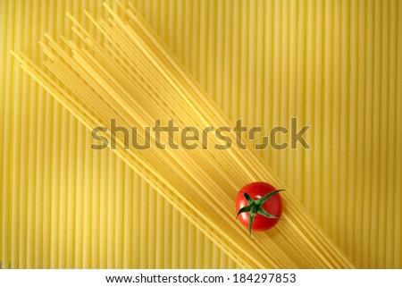 Spaghetti and cherry tomato still life, full frame - stock photo