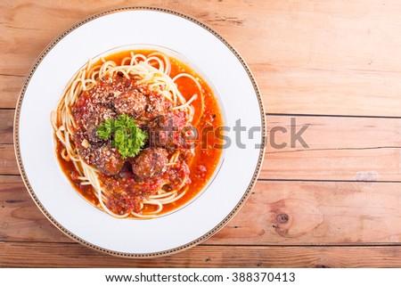 spaghetti and meatballs on the wood board. - stock photo