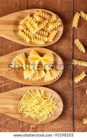 spaghetti and noodle on wooden table. - stock photo