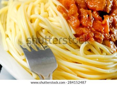 Spaghetti Bolognese on white plate. - stock photo