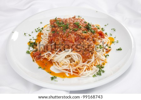 Spaghetti Bolognese w chopped parsley - stock photo