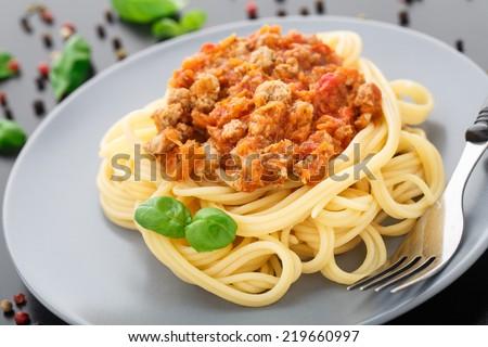 Spaghetti bolognese with basil leave - stock photo