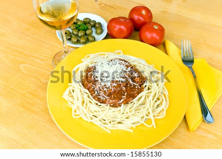 spaghetti bolognese with parmesan cheese and red wine - stock photo