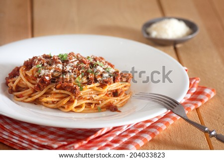 spaghetti bolognese with red napkin - stock photo